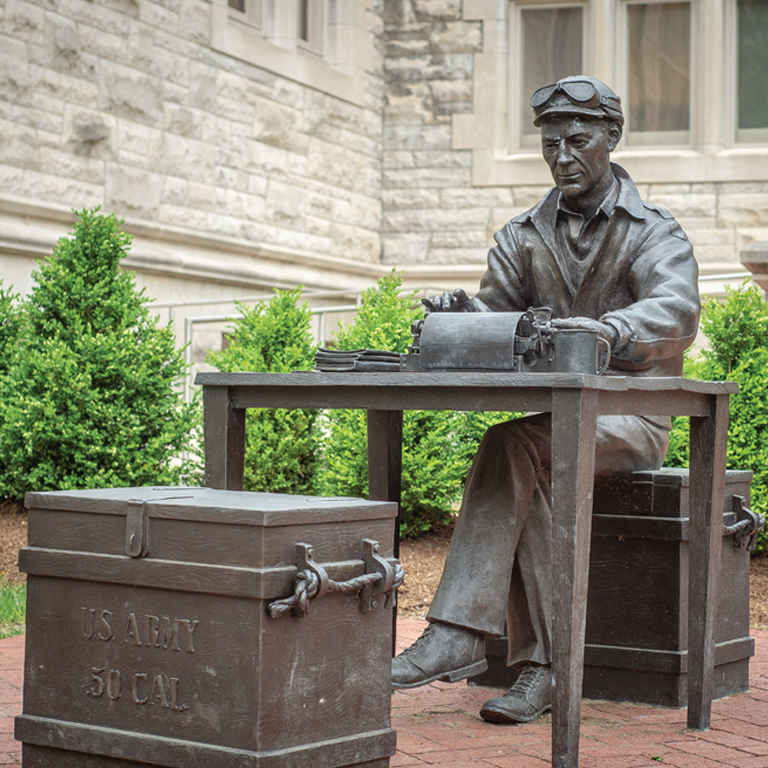 A statue of Ernie Pyle from the front entrance of Simon Hall.